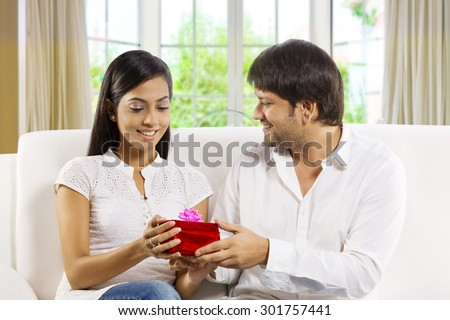 Man giving a gift to his wife