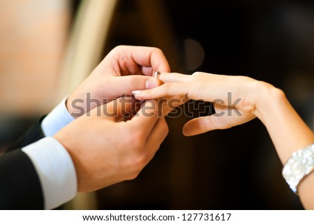 Man giving an engagement ring to his girlfriend