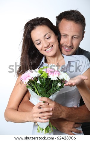 Man giving bunch of flowers to girlfriends