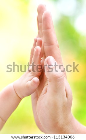 Man giving high five to his little son