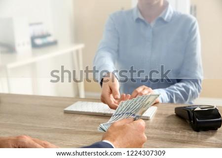 Man giving money to teller at cash department window, closeup Stock foto ©