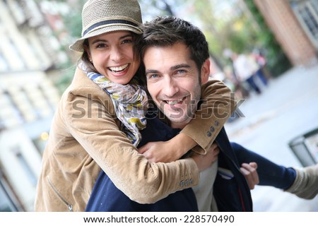 Man giving piggyback ride to girlfriend, having fun #228570490