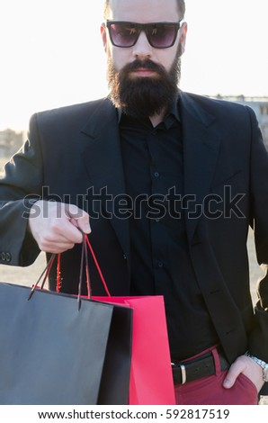 man giving shopping bags at the ...