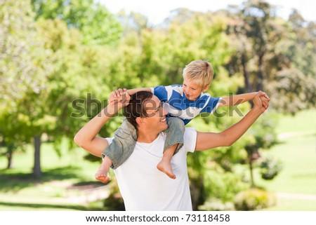 Man giving son a piggyback