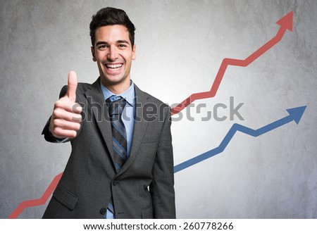 Man giving thumbs up in front of a positive diagram Stock photo ©