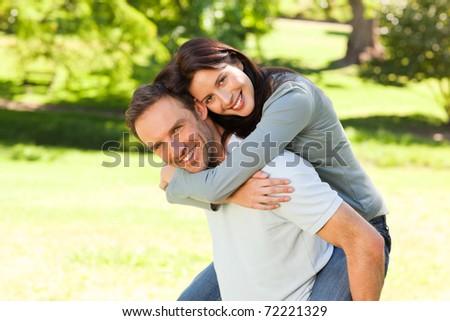 Man giving wife a piggyback