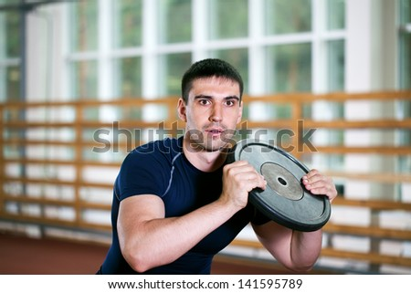 man goes in for sports in sport hall