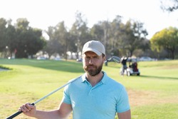man gold player in cap with golf stick on summer green grass, golfing