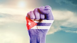 Man hand fist of Cuba flag painted