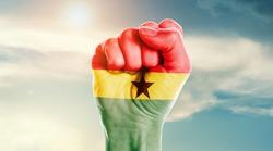 Man hand fist of Ghana flag painted