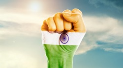 Man hand fist of India flag painted