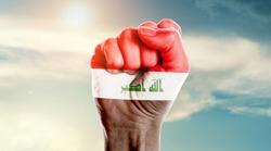Man hand fist of Iraq flag painted