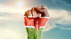Man hand fist of Kenya flag painted