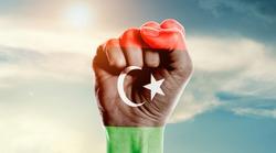 Man hand fist of Libya flag painted
