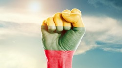 Man hand fist of Lithuania flag painted