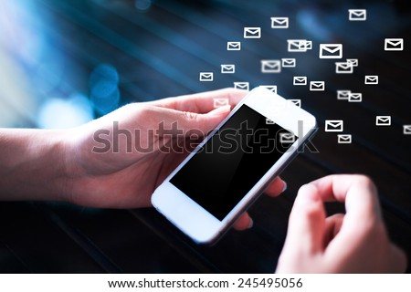Man hand holding a phone sending email,social media concept