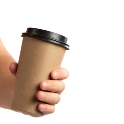 Man hand holding brown paper cup of coffee with black lid isolated on white background.