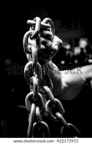 Man hand holding heavy chains #422173915