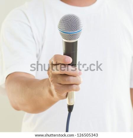 Man hand holding  microphone