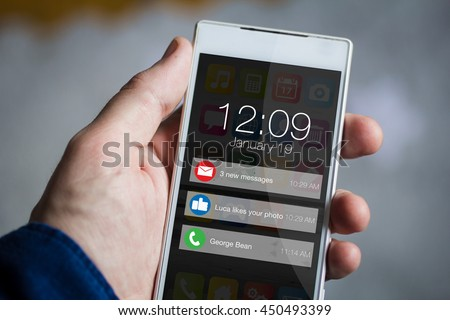 man hand holding notifications smartphone. All screen graphics are made up.
