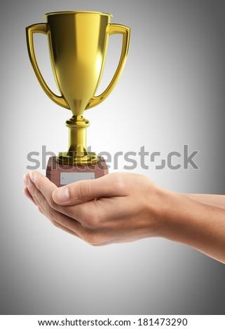 Man hand holding object ( golden trophy ) High resolution  #181473290