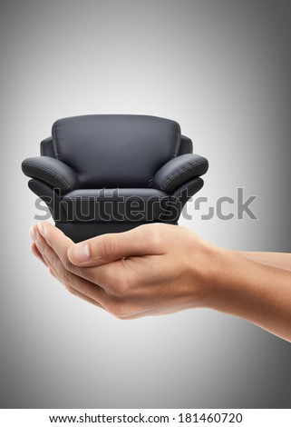 Man hand holding object ( modern leather chair ) High resolution