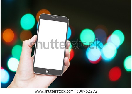 Man hand holding smart phone with isolated white screen,background of abstract bokeh light at night