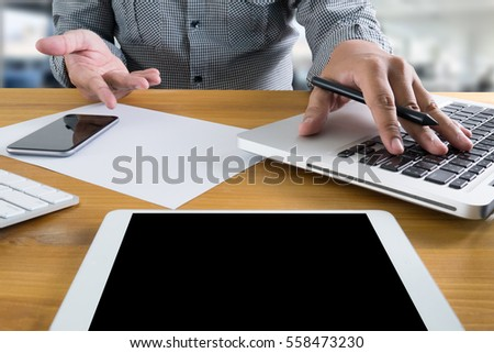 man hand holding smartphone device and  technology , businessman working with modern devices, digital tablet computer and mobile phone. #558473230