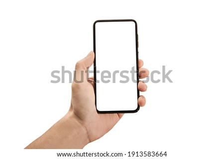 Man hand holding the black cell phone smartphone with blank white screen and modern frame less design - isolated on white background. Mockup phone. hand holding mobile phone