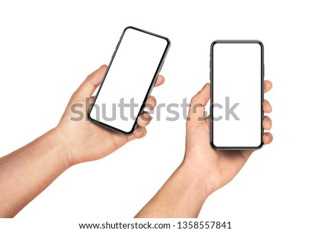Man hand holding the black smartphone set with blank screen and modern frame less design - isolated on white background #1358557841