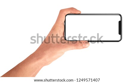 Man hand holding the black smartphone with blank screen horizontal and modern frame less design - isolated on white background