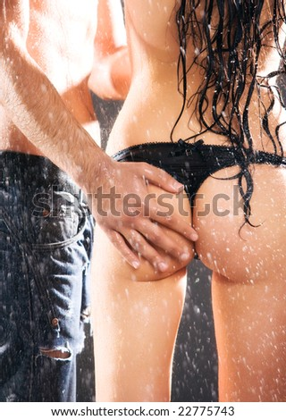 Man hand on sexy woman back. Water studio photo.