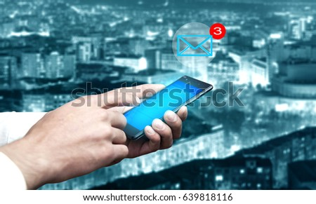 man hand phone with message in city background