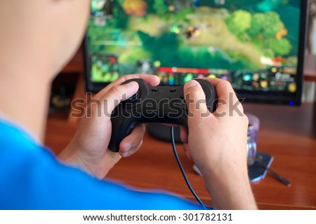 Man hand playing a computer games