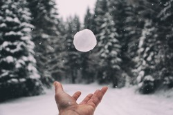 Man hand playing with snowball,winter holiday concept