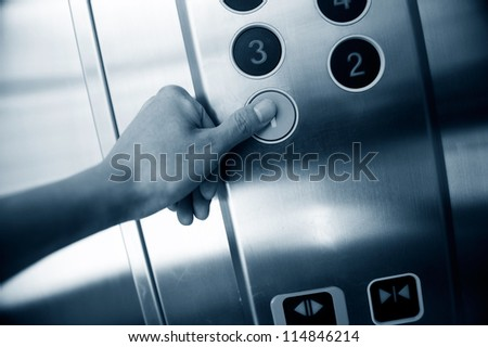 Man hand press 1 floor in elevator.