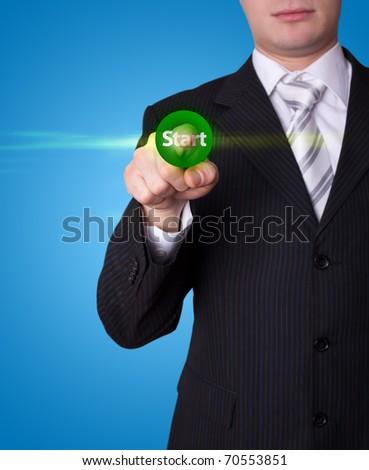 Man hand pressing Start button