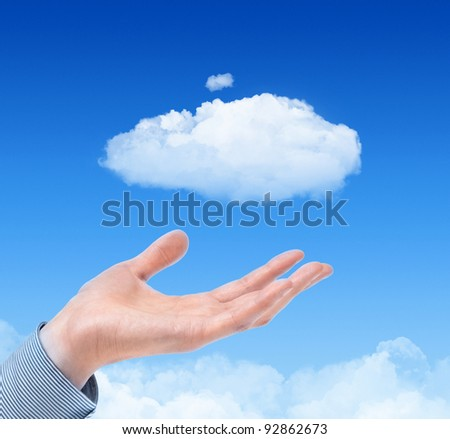 Man hand propose cloud against blue sky with clouds on background. Concept image on cloud computing and eco theme.