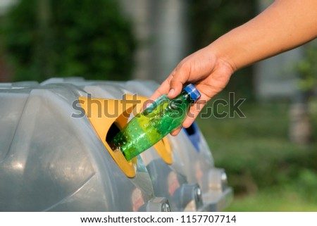 man hand putting plastic reuse for recycling concept environmental protection world recycle