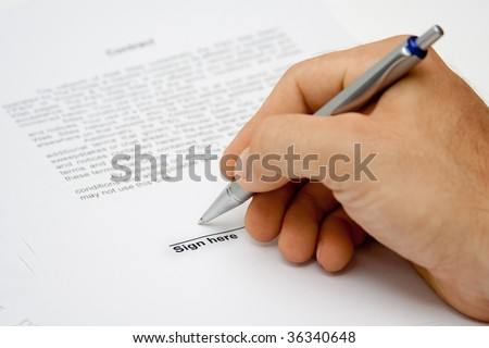 Man hand signing paper