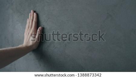 man hand touches decorative concrete finish #1388873342