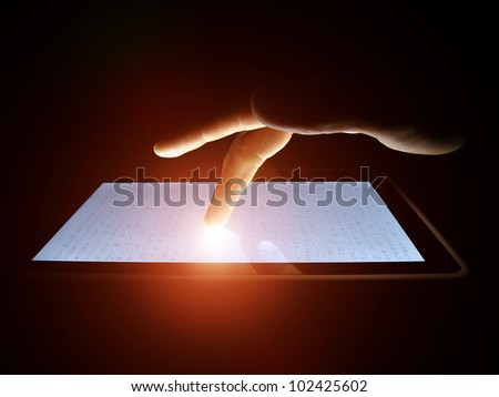 Man hand touching screen on modern digital tablet pc. Power of the technology concept.
