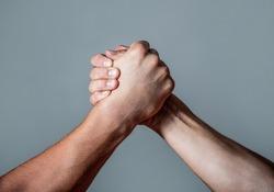 Man hand. Two men arm wrestling. Arms wrestling. Closep up. Friendly handshake, friends greeting, teamwork, friendship. Handshake, arms, friendship. Hand rivalry vs challenge strength comparison