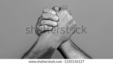 Man hand. Two men arm wrestling. Arms wrestling. Closep up. Friendly handshake, friends greeting, teamwork, friendship. Handshake, arms, friendship. Hand, rivalry, vs, challenge, strength comparison.