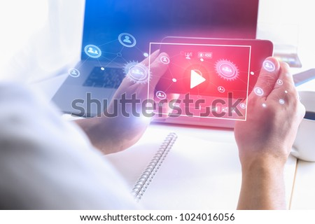 Man hand using Smartphone to watch Live streaming media online technology. #1024016056