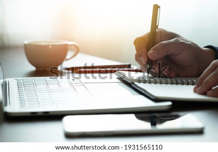 man hand using writing pen memo on notebook paper or letter, diary on table desk office. Workplace for student, writer with copy space. business working and learning education concept. Stockfoto ©