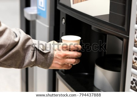 Man hand with coffee, vending coffee machine