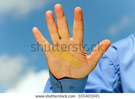 Man hand with medical plaster.