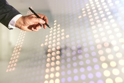 Man hand with pen draws abstract virtual upward arrows sketch on blurred office background, target and goal concept. Multiexposure