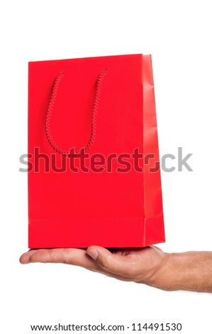 Man hand with red shopping bag isolated on white background